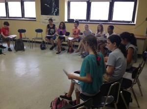Middle school students reviewing audition music in their singing class. They are all very excited and nervous!